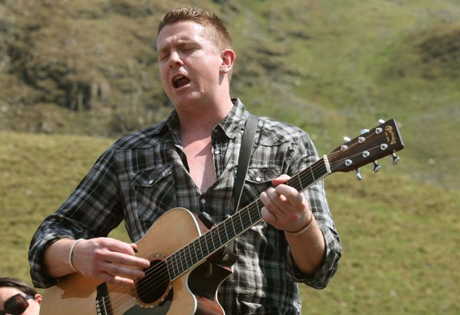 Damien Dempsey sings 'Choctaw Nation' at the 2010 Afri Famine Walk in Mayo. Photo by Derek Speirs