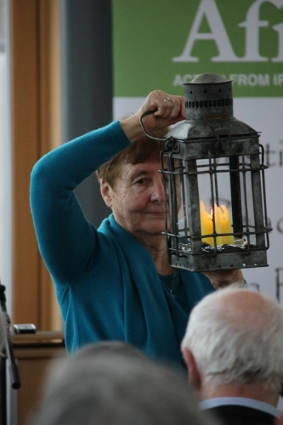 Mary Minehan carries in the Brigid Flame to open the 2015 conference.  Photo: Pauhla McGrane