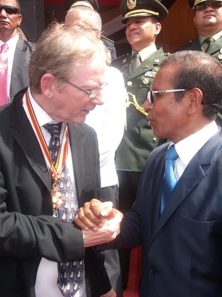 President Taur Matan Ruak presents Joe Murray with the 'Order of Timor-Leste' medal on behalf of on behalf of the East Timor Ireland Solidarity Campaign