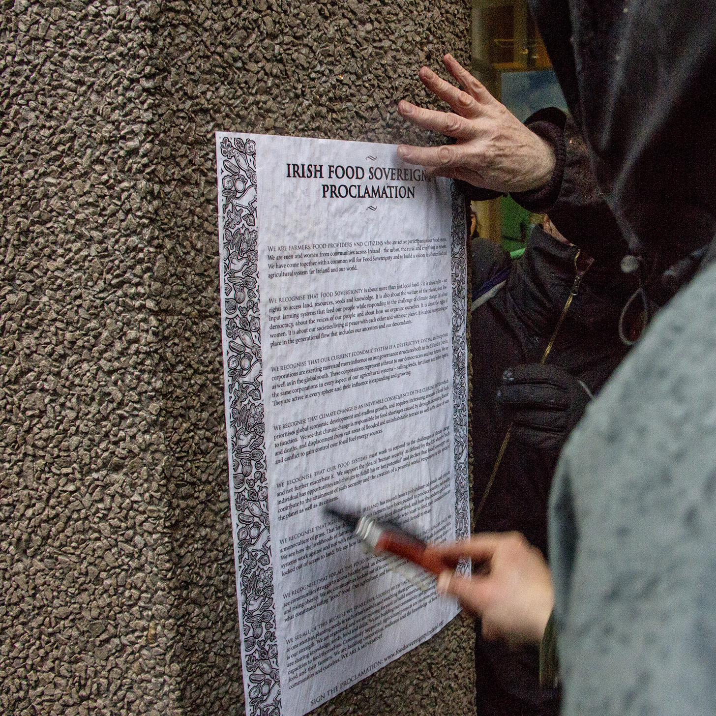 The Food Sovereignty Proclamation is pasted to the Department of Agriculture during the Climate March. Photo: William Hederman