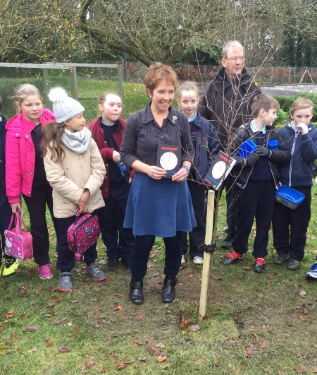 Pupils from Scoil Eoghain in Moville, with their teacher Rose Kelly as she launches her book 'Pathways of Peace' at at tree planting ceremony, in St. Columb's Park House, Derry on 4th December 2015