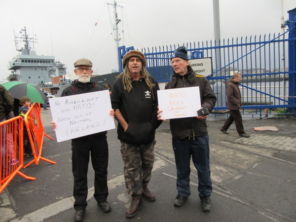 Afri board member, John Maguire, activist Ciaron O'Reilly and Afri Co-ordinator, Joe Murray at a protest action during the Easter weekend