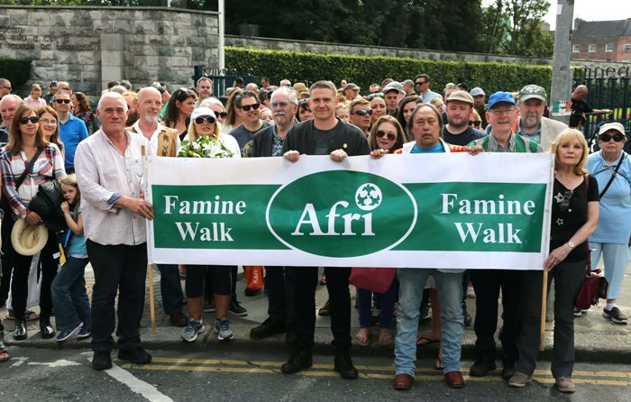 Damien Dempsey leads the walk from the Garden of Remembrance to Glasnevin cemetery organised as part of the Afri-Choctaw Famine Project. Photo by Derek Speirs